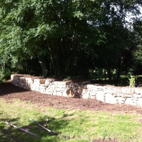 Wall finished Granite and mess cleared away, topsoiled and seeded