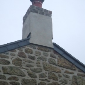 Lime render to stabilize and waterproof and old chimney. Extra courses of Portuguese granite added.
