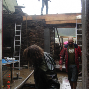 Casting the concrete lintel through the wall. The pillar you can see is to take the floor joist and is solidly fixed into the pad and the reinforcement all adding to the structural strength. You can see the timber shuttering forming the lintel.