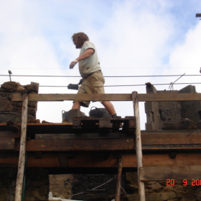 Here you can see the block work being faced off in local stone. Rue built the scaffolding out of local eucalyptus.