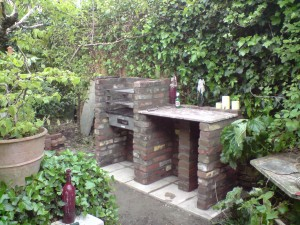 Lovely barby built with bricks after we removed a badly leaning  chimney .