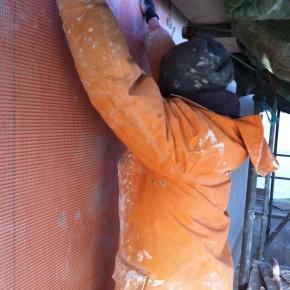 Here Richie is applying the nylon mesh.