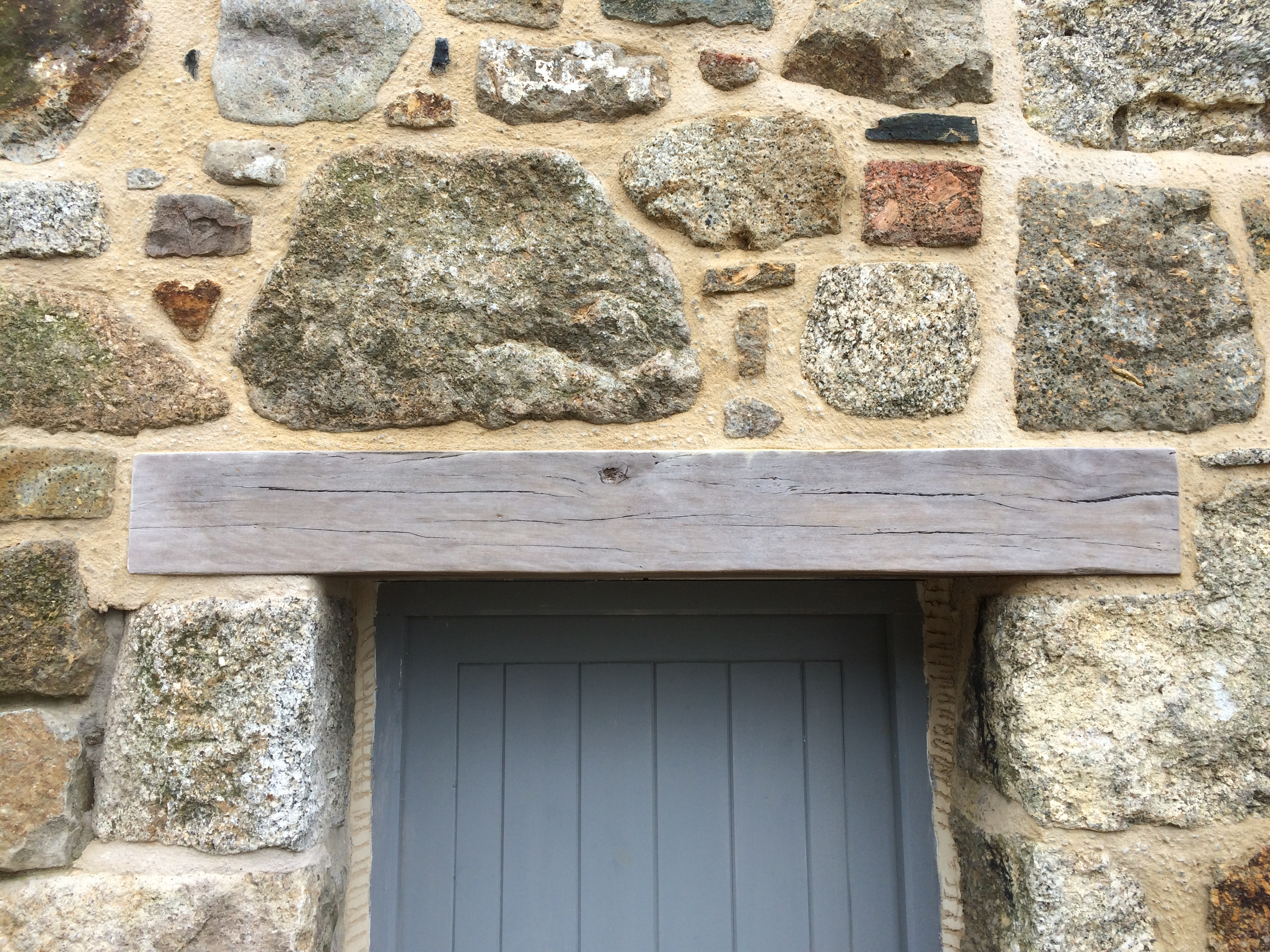 Reclaimed wood used as a lintel in this Cornish cottage extension